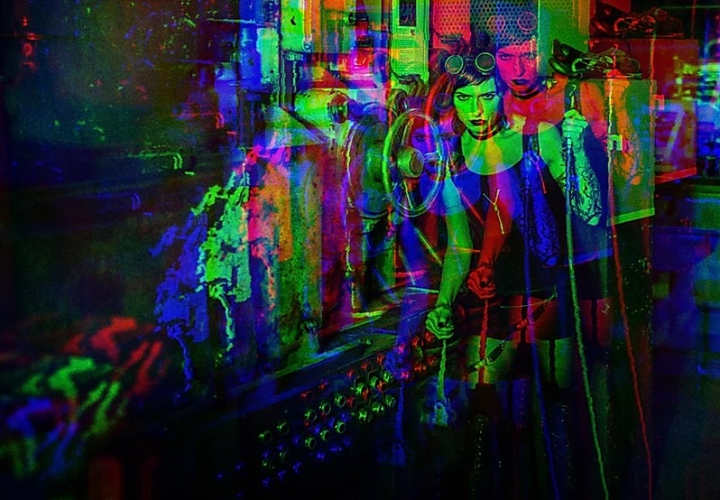 Multicolored psychedelic image of  a woman wearing aviator goggles on her head